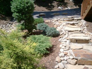 stone steps-steep slopes-hillside-gardening-landscaper