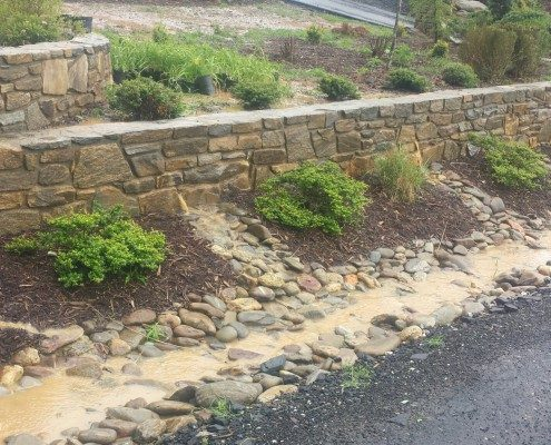 drainage-terraced landscaping-retaining walls-stone rock-gravel driveway