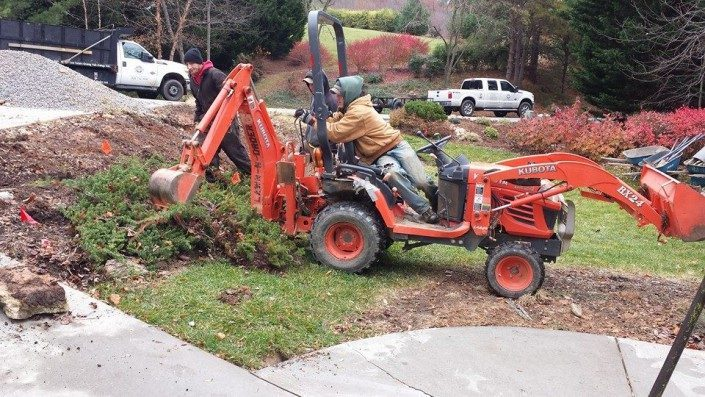 Kubota BX-24 tractor with backhoe-landscaper-lot clearing-tree removal