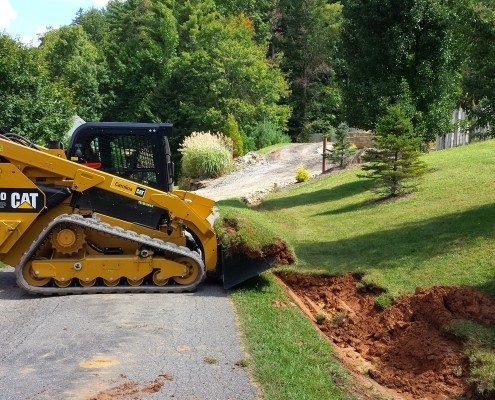 ditch-drainage-Cat- 299D-excavation-grading