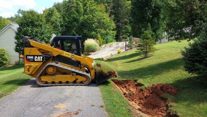 ditch-drainage-Cat- 299D-excavation-grading